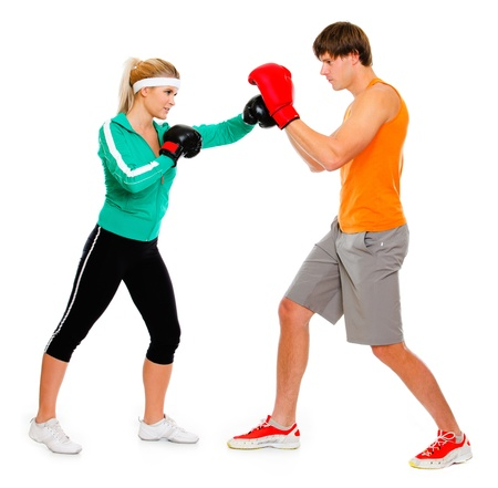 Young woman and man in boxing gloves practicing isolated on white  photo