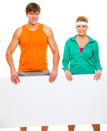 male athlete: Fitness girl and male athlete with blank billboard isolated on white