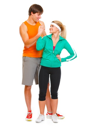 male athlete: Happy male athlete and fitness young woman handshaking isolated on white