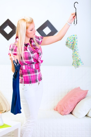 centrality: Young woman choosing what to dress Stock Photo
