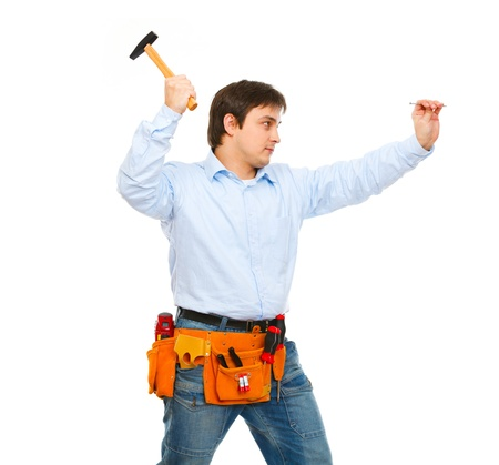 Construction worker hammering nail Stock Photo - 11826056
