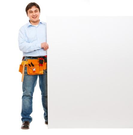 blank billboard: Gl�ckliche Bauarbeiter halten leere Plakatwand Lizenzfreie Bilder