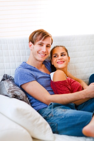 Happy young couple relaxing at home  photo