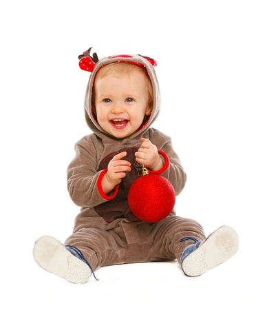 Portrait of happy lovely baby playing with Christmas ball  photo