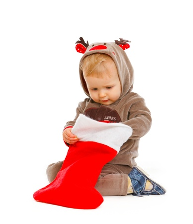 interrogatively: Curious lovely baby checking Christmas sock