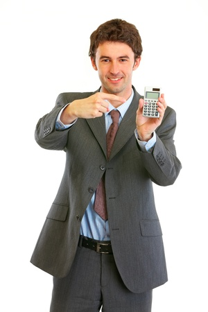 pointing finger: Smiling modern businessman pointing finger on calculator