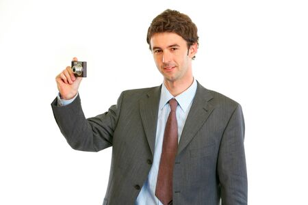 Happy man in business suit taking photo  photo