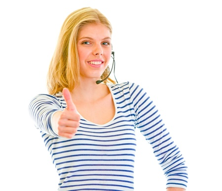 Smiling beautiful teen girl in headset showing thumbs up