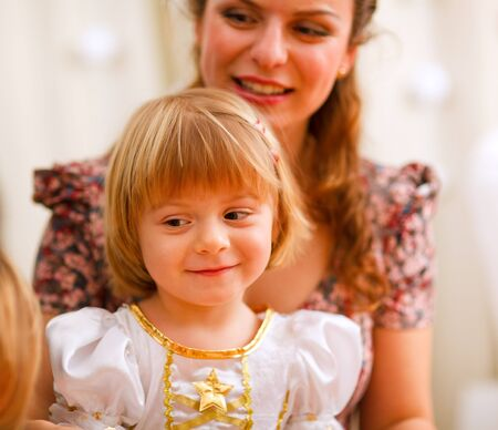 Portrait of mother and daughter looking on something Stock Photo - 12115024
