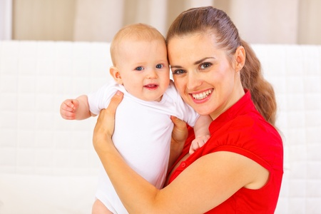 Portrait of adorable baby and young mother photo