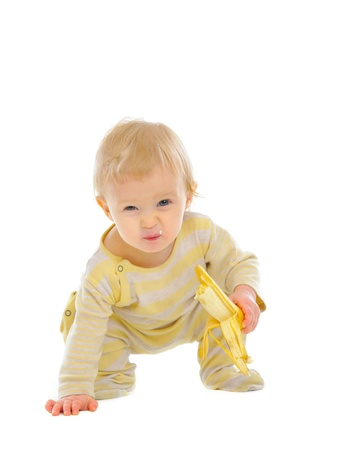 eating banana: Cheerful baby eating banana isolated on white