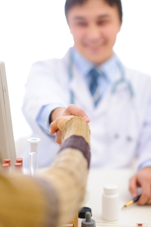 Closeup on handshake of medical doctor and patient Stock Photo - 12349991
