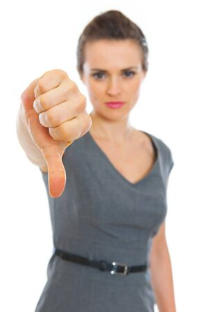 Business woman showing thumbs down. Focus on hand Stock Photo - 12351007