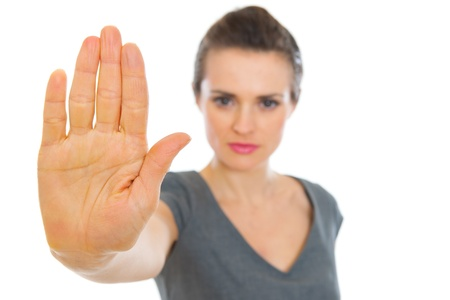 authoritative woman: Business woman showing stop gesture. Focus on hand Stock Photo
