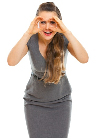 binoculars: Business woman looking through binoculars shaped hands Stock Photo
