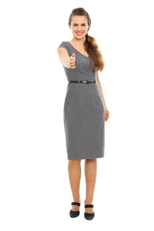 Full length portrait of business woman streching hand for handshake Stock Photo - 12350946