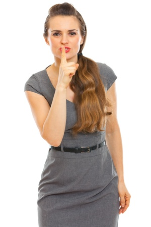 Business woman showing shhh gesture photo
