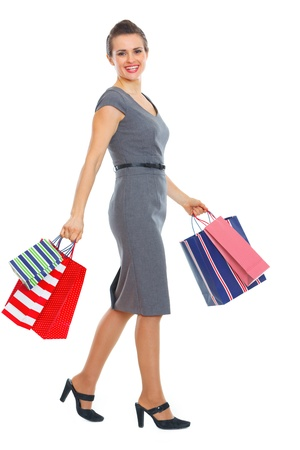 Full length portrait of happy woman with shopping bags Stock Photo - 12351002