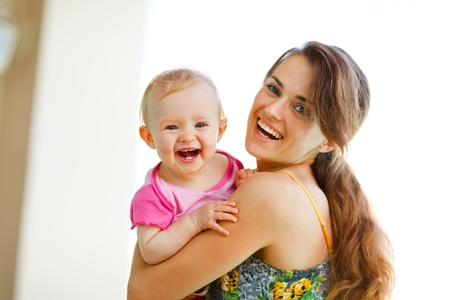 Portrait of laughing mother and baby Stock Photo - 12351525