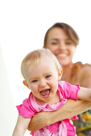 Cheerful baby playing with mother Stock Photo - 12351066