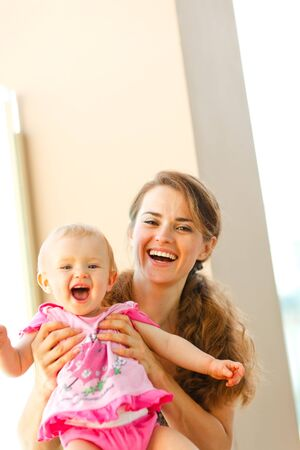 Portrait of smiling mother and baby Stock Photo - 12351209