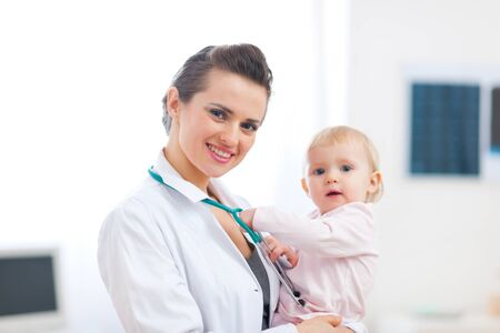 Portrait of pediatric doctor with baby Stock Photo - 12352740