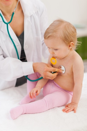 examine: Pediatric doctor examine baby Stock Photo