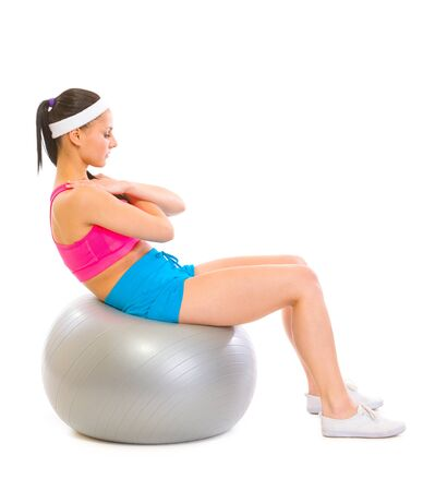 crunch: Fitness girl making abdominal crunch on fitness ball Stock Photo