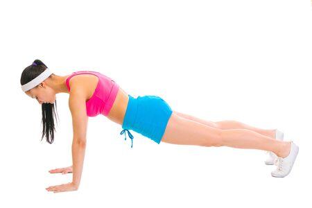 Healthy female making push up exercises photo