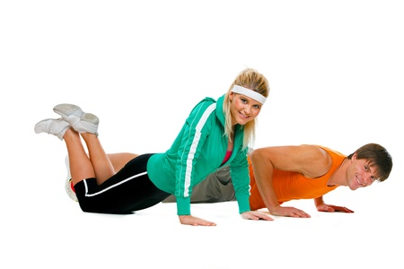 Fitness girl and male athlete making push up exerciser isolated on white Stock Photo - 12352235