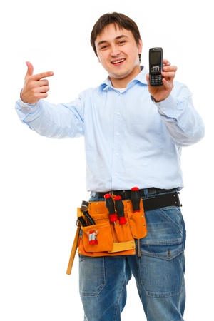 Construction worker pointing on mobile photo