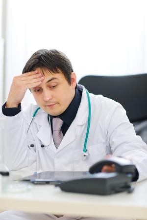 centrality: Concerned medical doctor picking up phone