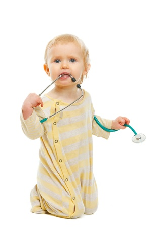 Curious kid playing with stethoscope on white background Stock Photo - 12354024