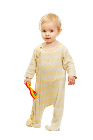 Cute kid standing with rattle on white background Stock Photo - 12353836