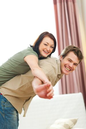 Smiling young couple in love enjoying themselves at home Stock Photo - 12355580