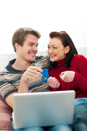 Young couple making online purchases Stock Photo - 12356484