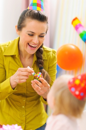 Mother celebrating first birthday of her baby Stock Photo - 12356154