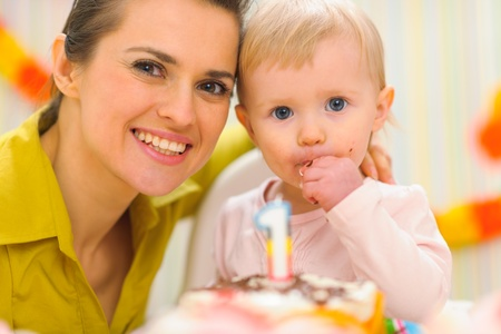 Portrait of mother and kid eating birthday cake Stock Photo - 12356614