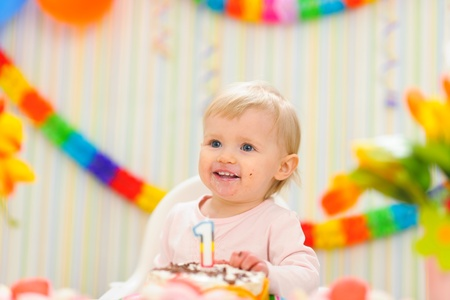 Portrait of eat smeared kid with first birthday cake Stock Photo - 12355590