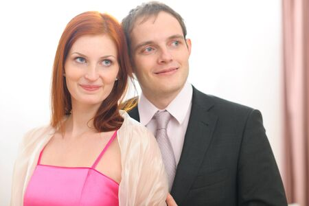 Portraits of formally dressed couple photo