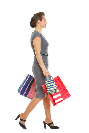 shoppingbags: Woman in dress walking with shopping bags