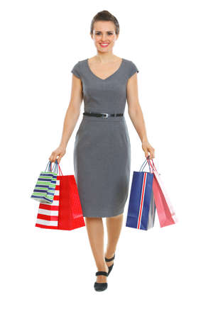 Female in dress walking with shopping bags Stock Photo - 12348877
