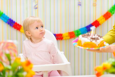 Surprised baby unexpecting birthday cake surprise photo