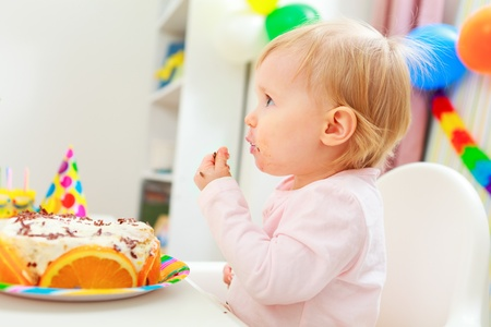 Eat smeared kid eating birthday cake photo