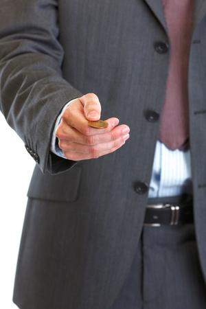 Closeup on man throwing up coin Stock Photo - 12711740