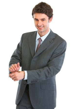 Modern business man showing tossed coin Stock Photo - 12637517