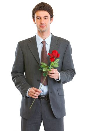 Portrait of happy man in suit with rose in hand photo