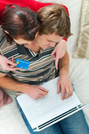 Young couple making purchases online Stock Photo - 12637741