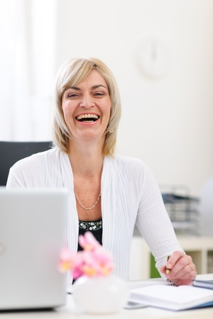 Portrait of smiling senior business woman at office Stock Photo - 12637782