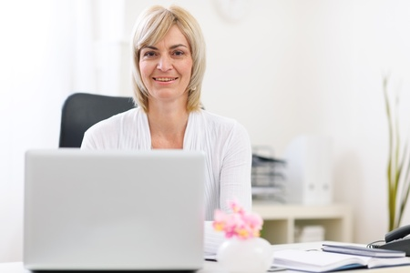 Portrait of happy senior business woman at office Stock Photo - 12637784